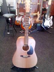 Скидка на акустическую гитару с цельной декой из Канады в Алматы!
